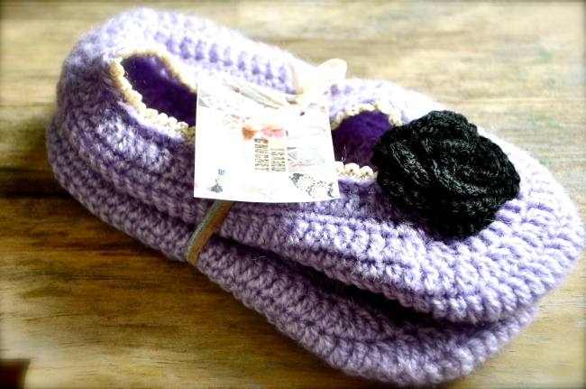 flower adorned crochet slippers