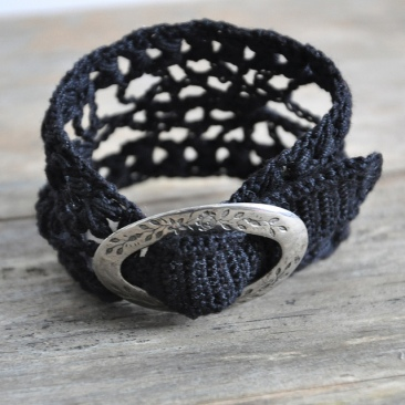 photo of the crochet cuff in black