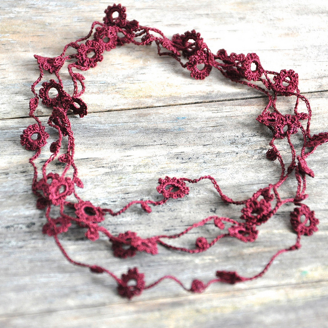 photo of the delicate crochet necklace in maroon